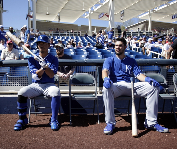 Mar 8, 2014; Phoenix, AZ, USA; Kansas City Royals right fielder Norichika Aoki (23) and first baseman Eric Hosmer (35) wait to hit before a game against the Milwaukee Brewers at Maryvale Baseball Park. Mandatory Credit: Rick Scuteri-USA TODAY Sports