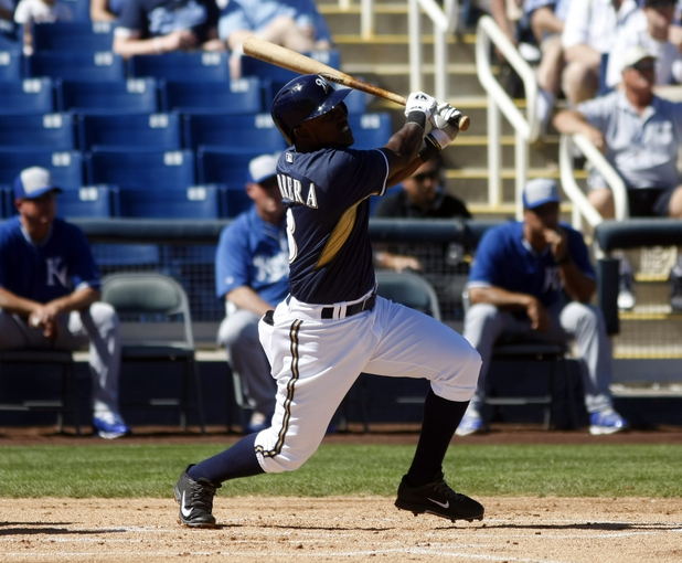 Mar 8, 2014; Phoenix, AZ, USA; Milwaukee Brewers third baseman Elian Herrera (3) doubles against the Kansas City Royals in the first inning at Maryvale Baseball Park. Mandatory Credit: Rick Scuteri-USA TODAY Sports