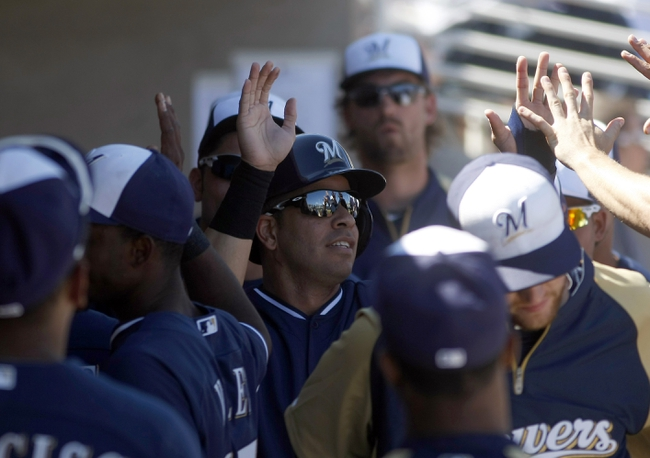 Mar 8, 2014; Phoenix, AZ, USA; Milwaukee Brewers third baseman Aramis Ramirez (16) gets high fives after scoring against the Kansas City Royals at Maryvale Baseball Park. Mandatory Credit: Rick Scuteri-USA TODAY Sports
