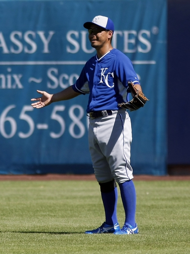 Mar 8, 2014; Phoenix, AZ, USA; Kansas City Royals right fielder Norichika Aoki (23) reacts during the third inning against the Milwaukee Brewers at Maryvale Baseball Park. Mandatory Credit: Rick Scuteri-USA TODAY Sports