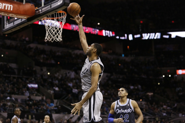 Mar 8, 2014; San Antonio, TX, USA; San Antonio Spurs forward Tim Duncan (21) shoots the ball as Orlando Magic forward Tobias Harris (12) looks on during the first half at AT&T Center. Mandatory Credit: Soobum Im-USA TODAY Sports