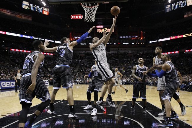 Mar 8, 2014; San Antonio, TX, USA; San Antonio Spurs guard Manu Ginobili (20) shoots the ball past Orlando Magic center Nikola Vucevic (9) during the first half at AT&T Center. Mandatory Credit: Soobum Im-USA TODAY Sports