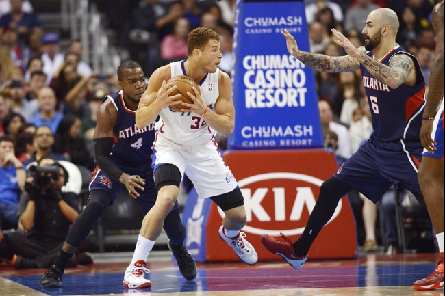 Mar 8, 2014; Los Angeles, CA, USA; Los Angeles Clippers forward Blake Griffin (32) moves the ball while defended by Atlanta Hawks forward Paul Millsap (4) during the first quarter at Staples Center. Mandatory Credit: Kelvin Kuo-USA TODAY Sports