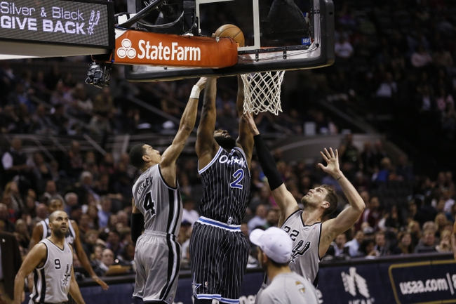 Mar 8, 2014; San Antonio, TX, USA; Orlando Magic forward Kyle O'Quinn (2) shoots the ball as San Antonio Spurs guard Danny Green (4) and forward Tiago Splitter (22) defend during the second half at AT&T Center. The Spurs won 121-112. Mandatory Credit: Soobum Im-USA TODAY Sports