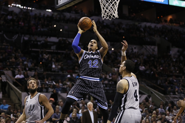 Mar 8, 2014; San Antonio, TX, USA; Orlando Magic forward Tobias Harris (12) puts up a shot against San Antonio Spurs guard Danny Green (4) during the second half at AT&T Center. The Spurs won 121-112. Mandatory Credit: Soobum Im-USA TODAY Sports