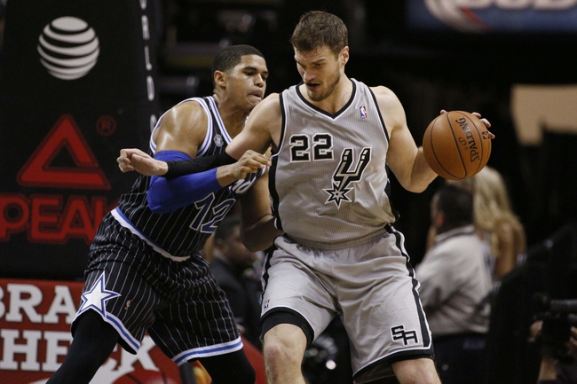 Mar 8, 2014; San Antonio, TX, USA; San Antonio Spurs forward Tiago Splitter (22) posts up against Orlando Magic forward Tobias Harris (12) during the second half at AT&T Center. The Spurs won 121-112. Mandatory Credit: Soobum Im-USA TODAY Sports