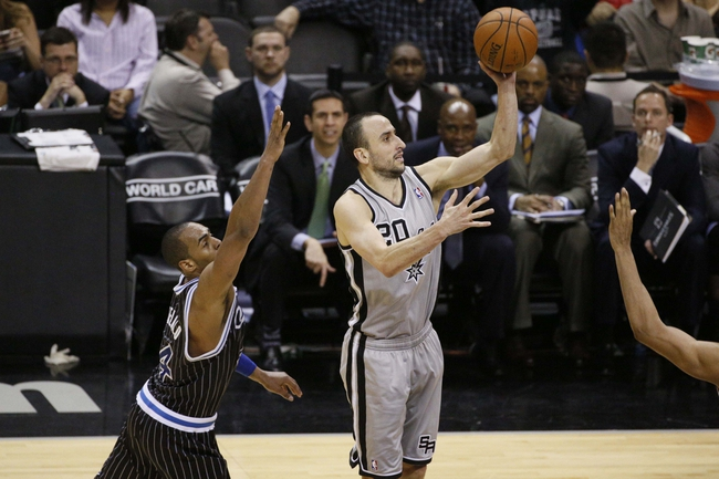 Mar 8, 2014; San Antonio, TX, USA; San Antonio Spurs guard Manu Ginobili (20) shoots the ball past Orlando Magic guard Arron Afflalo (4) during the second half at AT&T Center. The Spurs won 121-112. Mandatory Credit: Soobum Im-USA TODAY Sports