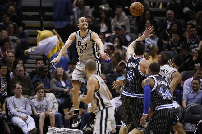 Mar 8, 2014; San Antonio, TX, USA; San Antonio Spurs guard Manu Ginobili (20) passes the ball during the second half against the Orlando Magic at AT&T Center. Mandatory Credit: Soobum Im-USA TODAY Sports