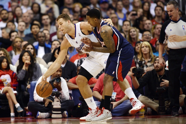 Mar 8, 2014; Los Angeles, CA, USA; Los Angeles Clippers forward Blake Griffin (32) and Atlanta Hawks guard Jeff Teague (0) battle for the loose ball during the second quarter at Staples Center. Mandatory Credit: Kelvin Kuo-USA TODAY Sports