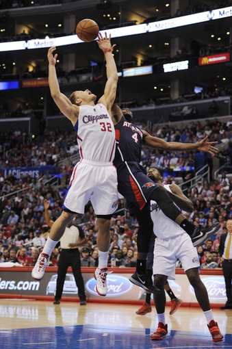 Mar 8, 2014; Los Angeles, CA, USA; Los Angeles Clippers forward Blake Griffin (32) and Atlanta Hawks forward Paul Millsap (4) battle for the rebound during the second quarter at Staples Center. Mandatory Credit: Kelvin Kuo-USA TODAY Sports