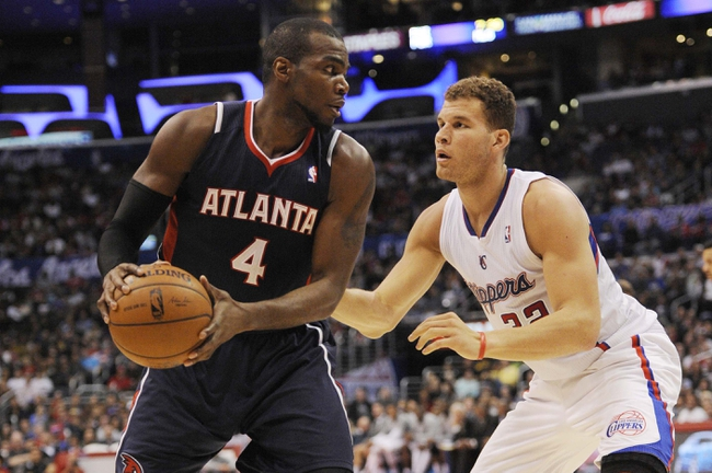 Mar 8, 2014; Los Angeles, CA, USA; Atlanta Hawks forward Paul Millsap (4) posts up on Los Angeles Clippers forward Blake Griffin (32) during the second quarter at Staples Center. Mandatory Credit: Kelvin Kuo-USA TODAY Sports