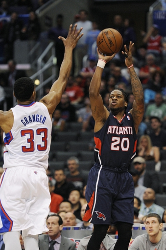 Mar 8, 2014; Los Angeles, CA, USA; Atlanta Hawks forward Cartier Martin (20) attempts a shot defended by Los Angeles Clippers forward Danny Granger (33) during the second quarter at Staples Center. Mandatory Credit: Kelvin Kuo-USA TODAY Sports