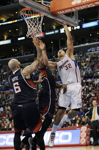 Mar 8, 2014; Los Angeles, CA, USA; Los Angeles Clippers forward Blake Griffin (32) attempts a shot while defended by Atlanta Hawks forward Paul Millsap (4) and center Pero Antic (6) during the fourth quarter at Staples Center. The Los Angeles Clippers defeated the Atlanta Hawks 109-108. Mandatory Credit: Kelvin Kuo-USA TODAY Sports