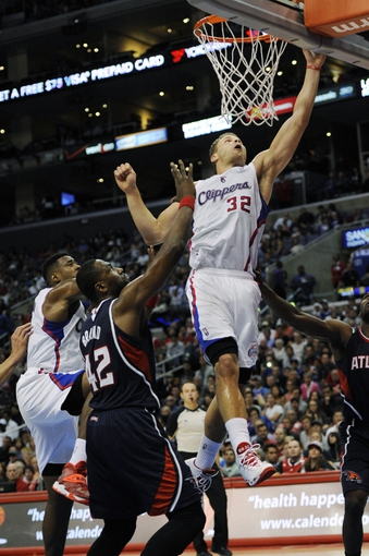 Mar 8, 2014; Los Angeles, CA, USA; Los Angeles Clippers forward Blake Griffin (32) attempts a shot against the Atlanta Hawks during the third quarter at Staples Center. The Los Angeles Clippers defeated the Atlanta Hawks 109-108. Mandatory Credit: Kelvin Kuo-USA TODAY Sports
