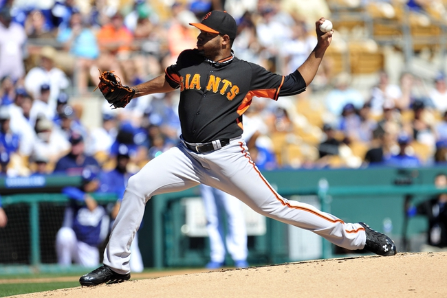 Mar 9, 2014; Glendale, AZ, USA; San Francisco Giants pitcher Edwin Escobar (82) pitches the first inning against the Los Angeles Dodgers at Camelback Ranch. Mandatory Credit: Gary A. Vasquez-USA TODAY Sports