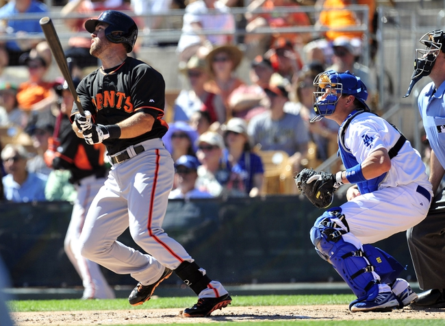 Mar 9, 2014; Glendale, AZ, USA; San Francisco Giants shortstop Brandon Hicks (14) hits a two run home run in the second inning against the Los Angeles Dodgers at Camelback Ranch. Mandatory Credit: Gary A. Vasquez-USA TODAY Sports