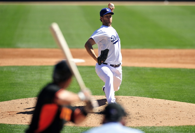 Mar 9, 2014; Glendale, AZ, USA; Los Angeles Dodgers starting pitcher Clayton Kershaw (22) pitches the third inning against the San Francisco Giants at Camelback Ranch. Mandatory Credit: Gary A. Vasquez-USA TODAY Sports