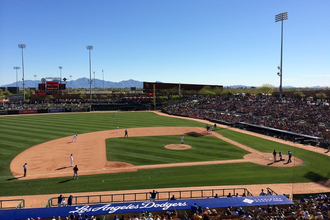 Mar 9, 2014; Glendale, AZ, USA; General view of game action as the Los Angeles Dodgers play against the San Francisco Giants at Camelback Ranch. Mandatory Credit: Gary A. Vasquez-USA TODAY Sports