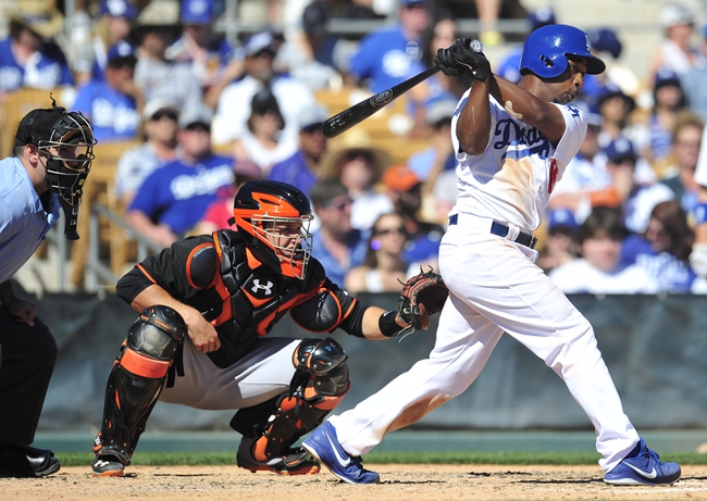 Mar 9, 2014; Glendale, AZ, USA; Los Angeles Dodgers left fielder Chone Figgins (18) hits a single in the fifth inning against the San Francisco Giants at Camelback Ranch. Mandatory Credit: Gary A. Vasquez-USA TODAY Sports
