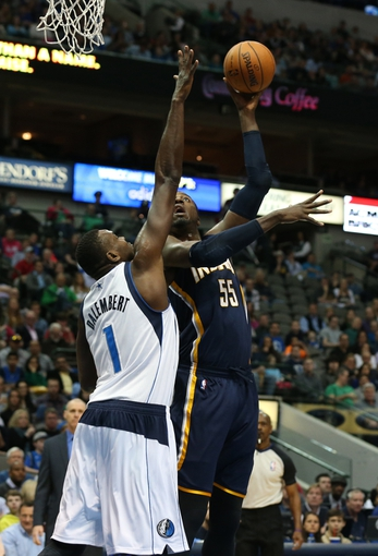 Mar 9, 2014; Dallas, TX, USA; Indiana Pacers center Roy Hibbert (55) shoots against Dallas Mavericks center Samuel Dalembert (1) in the first quarter at American Airlines Center. Mandatory Credit: Matthew Emmons-USA TODAY Sports