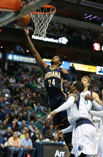 Mar 9, 2014; Dallas, TX, USA; Indiana Pacers forward Paul George (24) shoots against the Dallas Mavericks in the first quarter at American Airlines Center. Mandatory Credit: Matthew Emmons-USA TODAY Sports