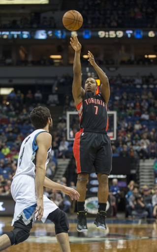 Mar 9, 2014; Minneapolis, MN, USA; Toronto Raptors point guard Kyle Lowry (7) goes up for a shot over Minnesota Timberwolves point guard Ricky Rubio (9) in the first half at Target Center. Mandatory Credit: Jesse Johnson-USA TODAY Sports