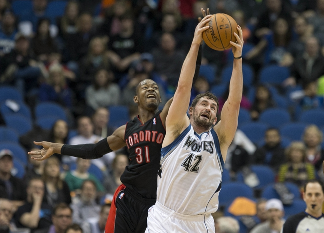 Mar 9, 2014; Minneapolis, MN, USA; Minnesota Timberwolves power forward Kevin Love (42) and Toronto Raptors small forward Terrence Ross (31) fight for a loose ball in the first half at Target Center. Mandatory Credit: Jesse Johnson-USA TODAY Sports