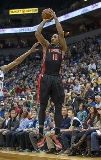 Mar 9, 2014; Minneapolis, MN, USA; Toronto Raptors shooting guard DeMar DeRozan (10) goes up for a shot in the first half against the Minnesota Timberwolves at Target Center. Mandatory Credit: Jesse Johnson-USA TODAY Sports