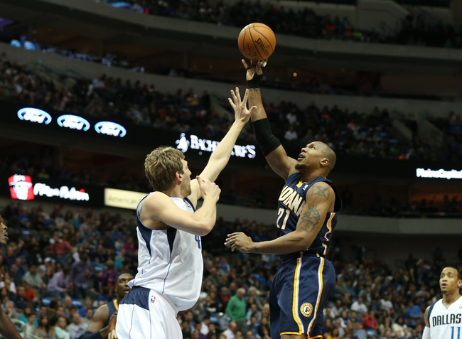 Mar 9, 2014; Dallas, TX, USA; Indiana Pacers forward David West (21) shoots against Dallas Mavericks forward Dirk Nowitzki (41) in the first quarter at American Airlines Center. Mandatory Credit: Matthew Emmons-USA TODAY Sports