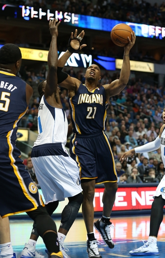 Mar 9, 2014; Dallas, TX, USA; Indiana Pacers forward David West (21) shoots against Dallas Mavericks  center Samule Dalembert (1) in the first quarter at American Airlines Center. Mandatory Credit: Matthew Emmons-USA TODAY Sports