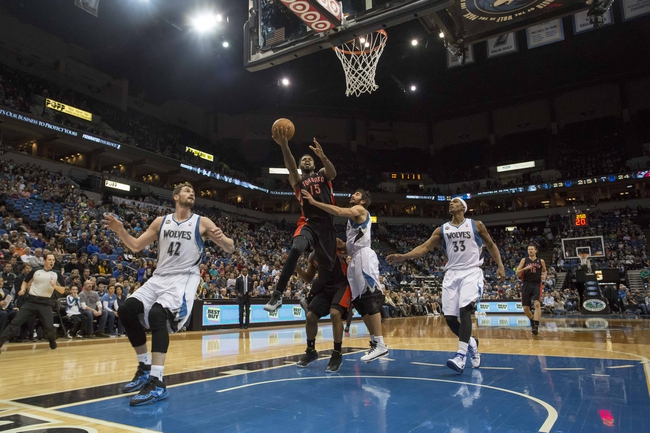 Mar 9, 2014; Minneapolis, MN, USA; Toronto Raptors power forward Amir Johnson (15) goes up for a layup past Minnesota Timberwolves point guard Ricky Rubio (9) in the first half at Target Center. Mandatory Credit: Jesse Johnson-USA TODAY Sports