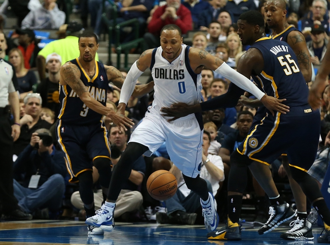 Mar 9, 2014; Dallas, TX, USA; Dallas Mavericks forward Shawn Marion (0) fights for a loose ball against Indiana Pacers center Roy Hibbert (55) and guard George Hill (3) in the first quarter at American Airlines Center. Mandatory Credit: Matthew Emmons-USA TODAY Sports