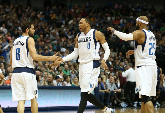 Mar 9, 2014; Dallas, TX, USA; Dallas Mavericks forward Shawn Marion (0) celebrates with guard Jose Caulderon (8) and Vince Carter (25) after a basket in the second quarter against the Indiana Pacers at American Airlines Center. Mandatory Credit: Matthew Emmons-USA TODAY Sports