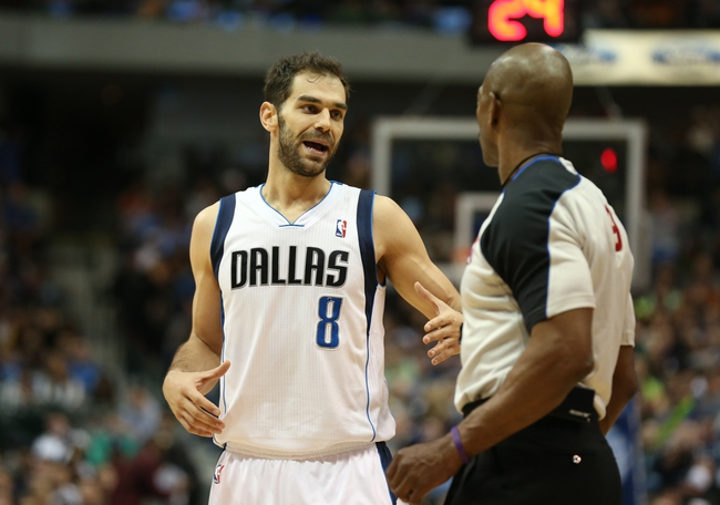 Mar 9, 2014; Dallas, TX, USA; Dallas Mavericks guard Jose Calderon (8) talks with a referee against the Indiana Pacers at American Airlines Center. Mandatory Credit: Matthew Emmons-USA TODAY Sports