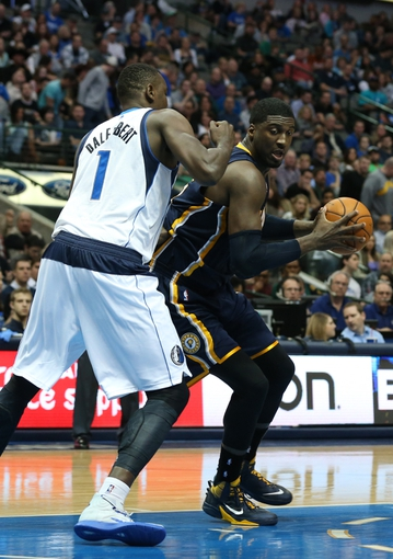 Mar 9, 2014; Dallas, TX, USA; Indiana Pacers center Roy Hibbert (55) drives against Dallas Mavericks center Samuel Dalembert (1) in the second quarter at American Airlines Center. Mandatory Credit: Matthew Emmons-USA TODAY Sports