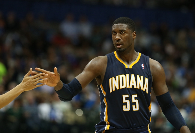 Mar 9, 2014; Dallas, TX, USA; Indiana Pacers center Roy Hibbert (55) celebrates after making a basket and getting fouled in the second quarter against the Dallas Mavericks at American Airlines Center. Mandatory Credit: Matthew Emmons-USA TODAY Sports