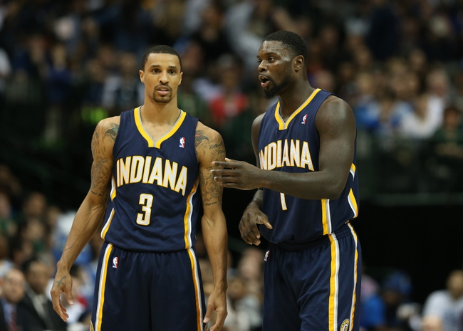Mar 9, 2014; Dallas, TX, USA; Indiana Pacers guard Lance Stephenson (1) talks with guard George Hill (3) during a timeout in the second quarter against the Dallas Mavericks at American Airlines Center. Mandatory Credit: Matthew Emmons-USA TODAY Sports