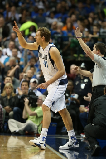 Mar 9, 2014; Dallas, TX, USA; Dallas Mavericks forward Dirk Nowitzki (41) celebrates a three point basket in the first quarter against the Indiana Pacers at American Airlines Center. Mandatory Credit: Matthew Emmons-USA TODAY Sports