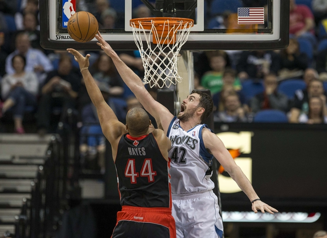 Mar 9, 2014; Minneapolis, MN, USA; Minnesota Timberwolves power forward Kevin Love (42) attempts to block a shot by Toronto Raptors power forward Chuck Hayes (44) in the second half at Target Center. The Raptors won 111-104. Mandatory Credit: Jesse Johnson-USA TODAY Sports