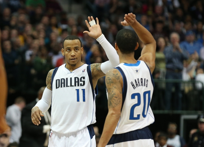 Mar 9, 2014; Dallas, TX, USA; Dallas Mavericks guard Monta Ellis (11) celebrates with guard Devin Harris (20) after a basket in the fourth quarter against the Indiana Pacers at American Airlines Center. The Mavs beat the Pacers 105-94. Mandatory Credit: Matthew Emmons-USA TODAY Sports