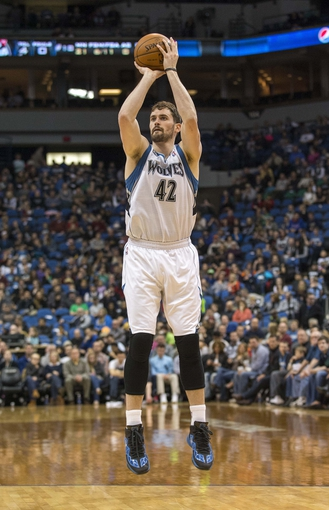 Mar 9, 2014; Minneapolis, MN, USA; Minnesota Timberwolves power forward Kevin Love (42) goes up for a shot in the second half against the Toronto Raptors at Target Center. The Raptors won 111-104. Mandatory Credit: Jesse Johnson-USA TODAY Sports
