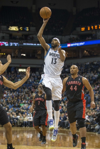 Mar 9, 2014; Minneapolis, MN, USA; Minnesota Timberwolves small forward Corey Brewer (13) goes up for a shot in the second half against the Toronto Raptors at Target Center. The Raptors won 111-104. Mandatory Credit: Jesse Johnson-USA TODAY Sports