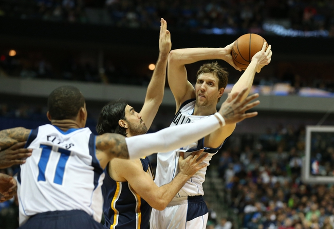 Mar 9, 2014; Dallas, TX, USA; Dallas Mavericks forward Dirk Nowitzki (41) looks to pass to guard Monta Ellis (11) in the second half against Indiana Pacers forward Luis Scola (4) at American Airlines Center. The Mavs beat the Pacers 105-94. Mandatory Credit: Matthew Emmons-USA TODAY Sports
