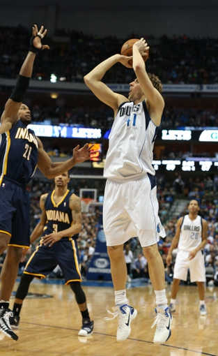 Mar 9, 2014; Dallas, TX, USA; Dallas Mavericks forward Dirk Nowitzki (41) shoots in the second half against Indiana Pacers forward David West (21) at American Airlines Center. The Mavs beat the Pacers 105-94. Mandatory Credit: Matthew Emmons-USA TODAY Sports