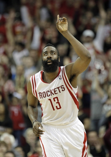 Mar 9, 2014; Houston, TX, USA; Houston Rockets shooting guard James Harden (13) celebrates after making a shot during the overtime period against the Portland Trail Blazers at Toyota Center. Mandatory Credit: Andrew Richardson-USA TODAY Sports