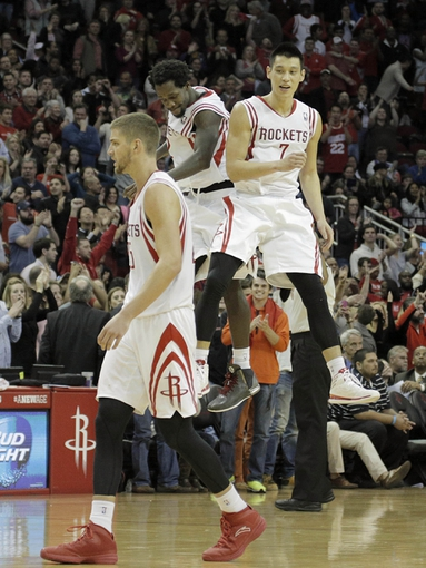 Mar 9, 2014; Houston, TX, USA; Houston Rockets point guard Patrick Beverley (2) and point guard Jeremy Lin (7) celebrate during the overtime period against the Portland Trail Blazers at Toyota Center. Mandatory Credit: Andrew Richardson-USA TODAY Sports