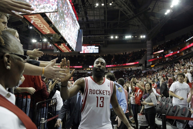 Mar 9, 2014; Houston, TX, USA; Houston Rockets shooting guard James Harden (13) high-fives fans following the end of overtime against the Portland Trail Blazers at Toyota Center. Mandatory Credit: Andrew Richardson-USA TODAY Sports