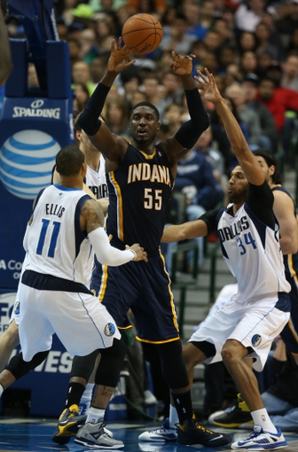 Mar 9, 2014; Dallas, TX, USA; Indiana Pacers center Roy Hibbert (55) passes out of a triple team by Dallas Mavericks guard Monta Ellis (11) center Brandan Wright (34) and Dirk Nowitzki (41) at American Airlines Center. The Mavs beat the Pacers 105-94. Mandatory Credit: Matthew Emmons-USA TODAY Sports