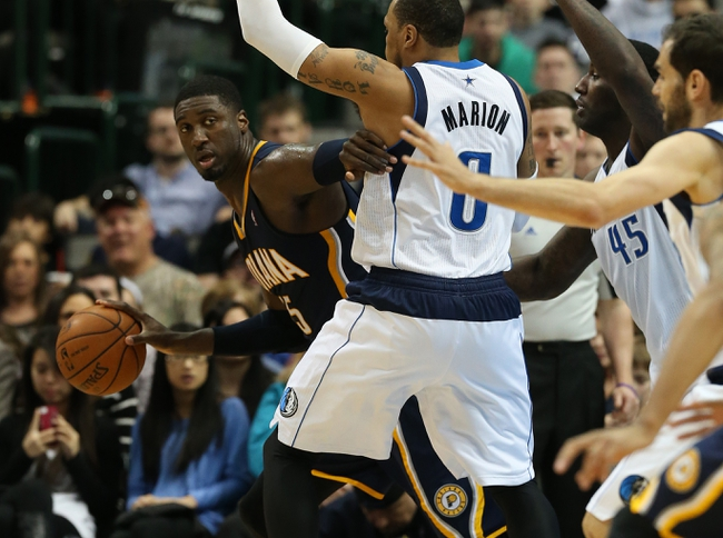 Mar 9, 2014; Dallas, TX, USA; Indiana Pacers center Roy Hibbert (55) fights to drive past Dallas Mavericks forward Shawn Marion (0) in the second half at American Airlines Center. The Mavs beat the Pacers 105-94. Mandatory Credit: Matthew Emmons-USA TODAY Sports