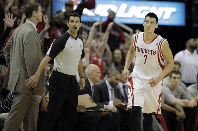 Mar 9, 2014; Houston, TX, USA; Houston Rockets point guard Jeremy Lin (7) reacts to a made shot during the overtime period against the Portland Trail Blazers at Toyota Center. Mandatory Credit: Andrew Richardson-USA TODAY Sports
